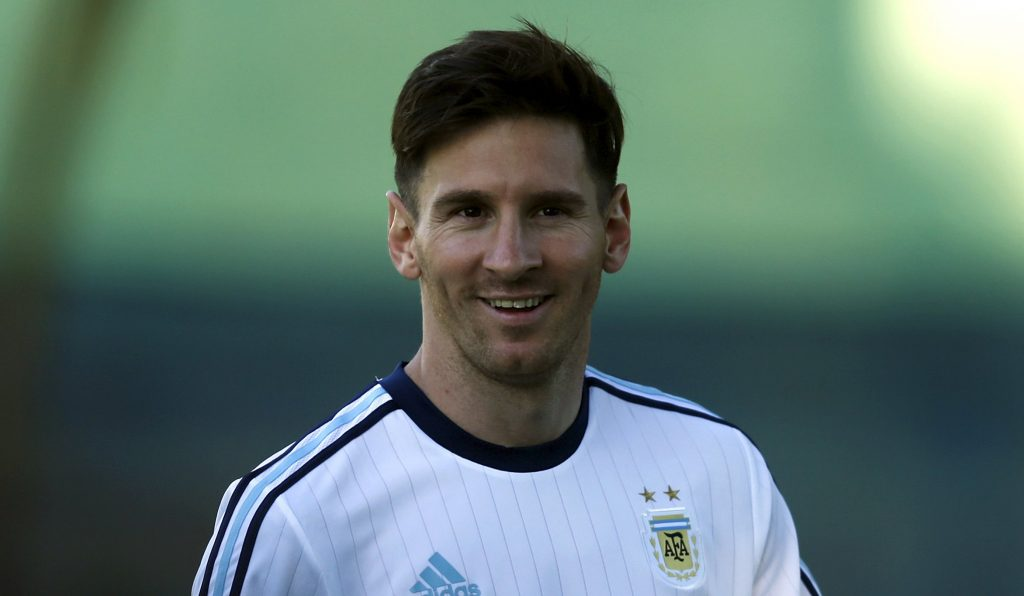 Argentina's Lionel Messi smiles during a training session in La Serena, June 9, 2015. Argentina will play the group B matches along with Paraguay, Uruguay and Jamaica in the upcoming Copa America 2015 soccer tournament in Chile. REUTERS/Marcos Brindicci