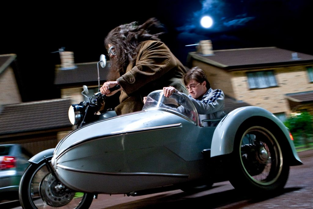 Everyone mounts up and leaves Privet Drive. Harry and Hagrid (Greg Powell) take the bike. (SC22)